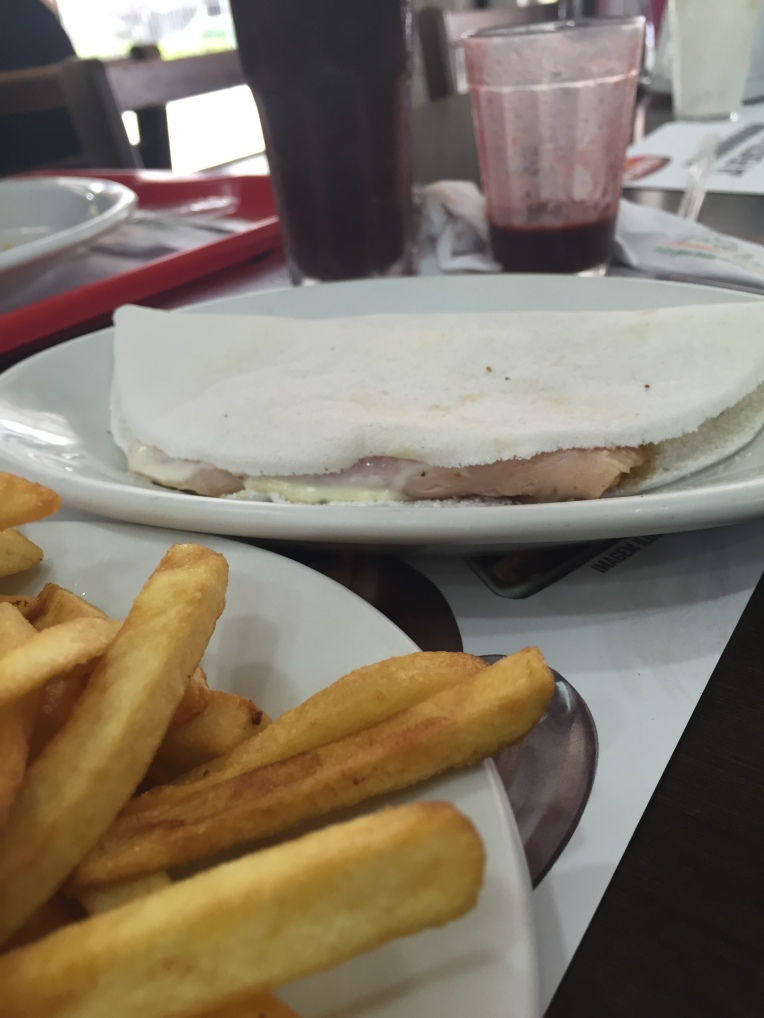 Tapioca (manioc crepe) filled with cheese and turkey breast)